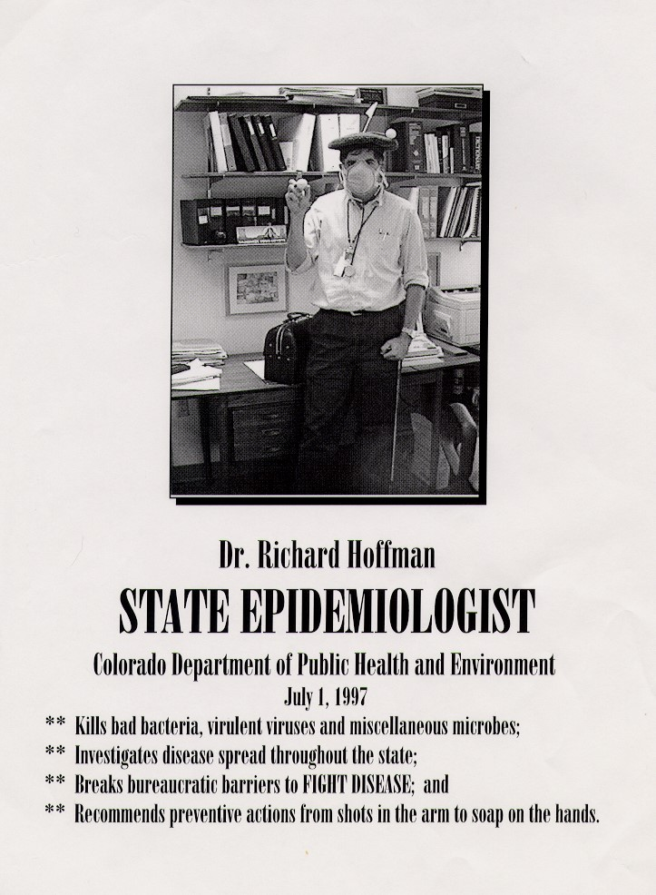 Black and white poster with a young Dr. Richard Hoffman standing in an office wearing a medical mask