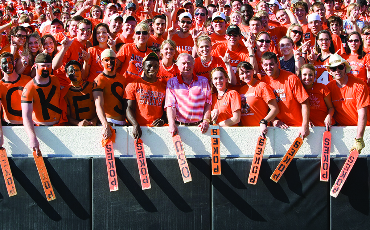Oklahoma State University fans at a sports event with T. Boone Pickens